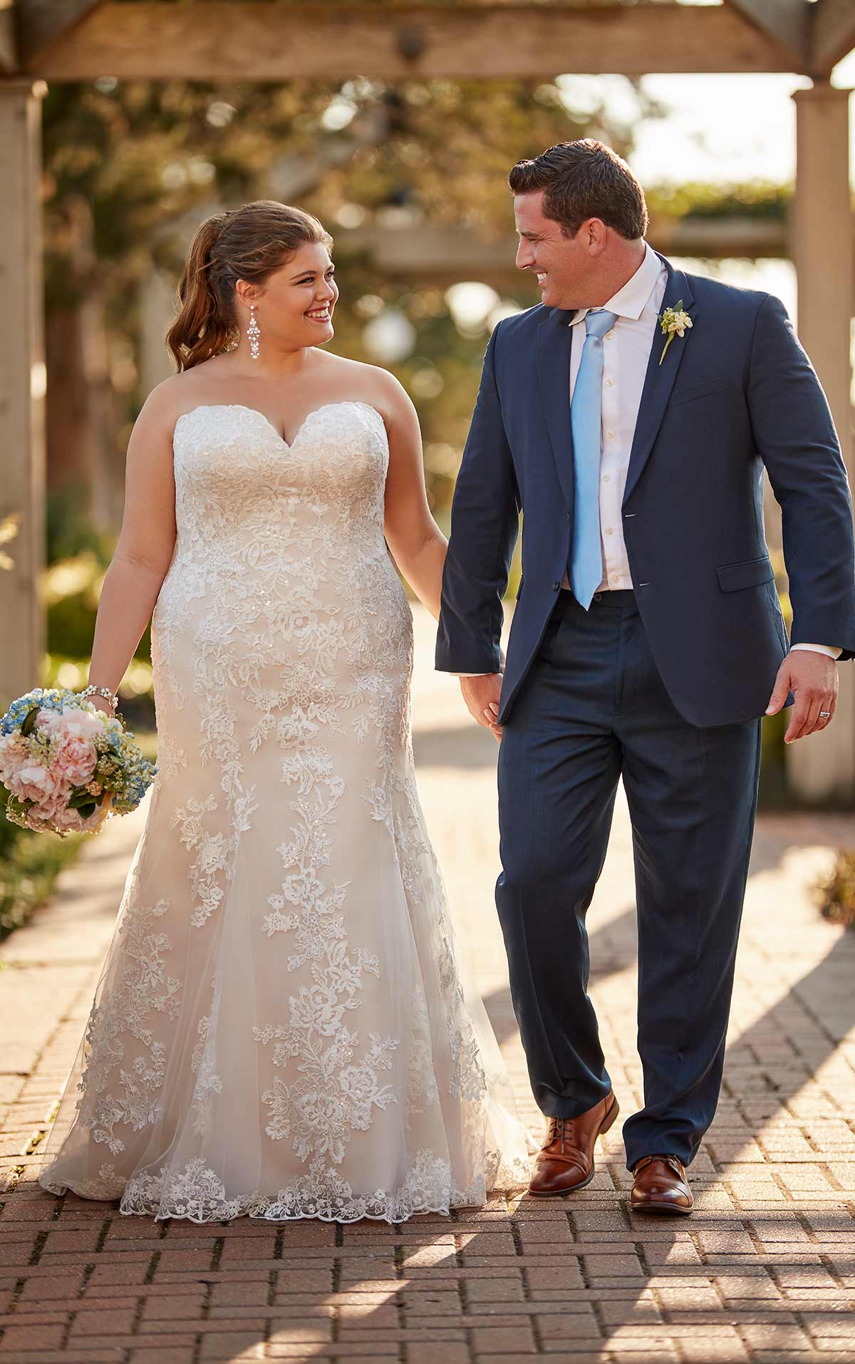 plus-sized bride wearing fit and flare gown with sweetheart neckline