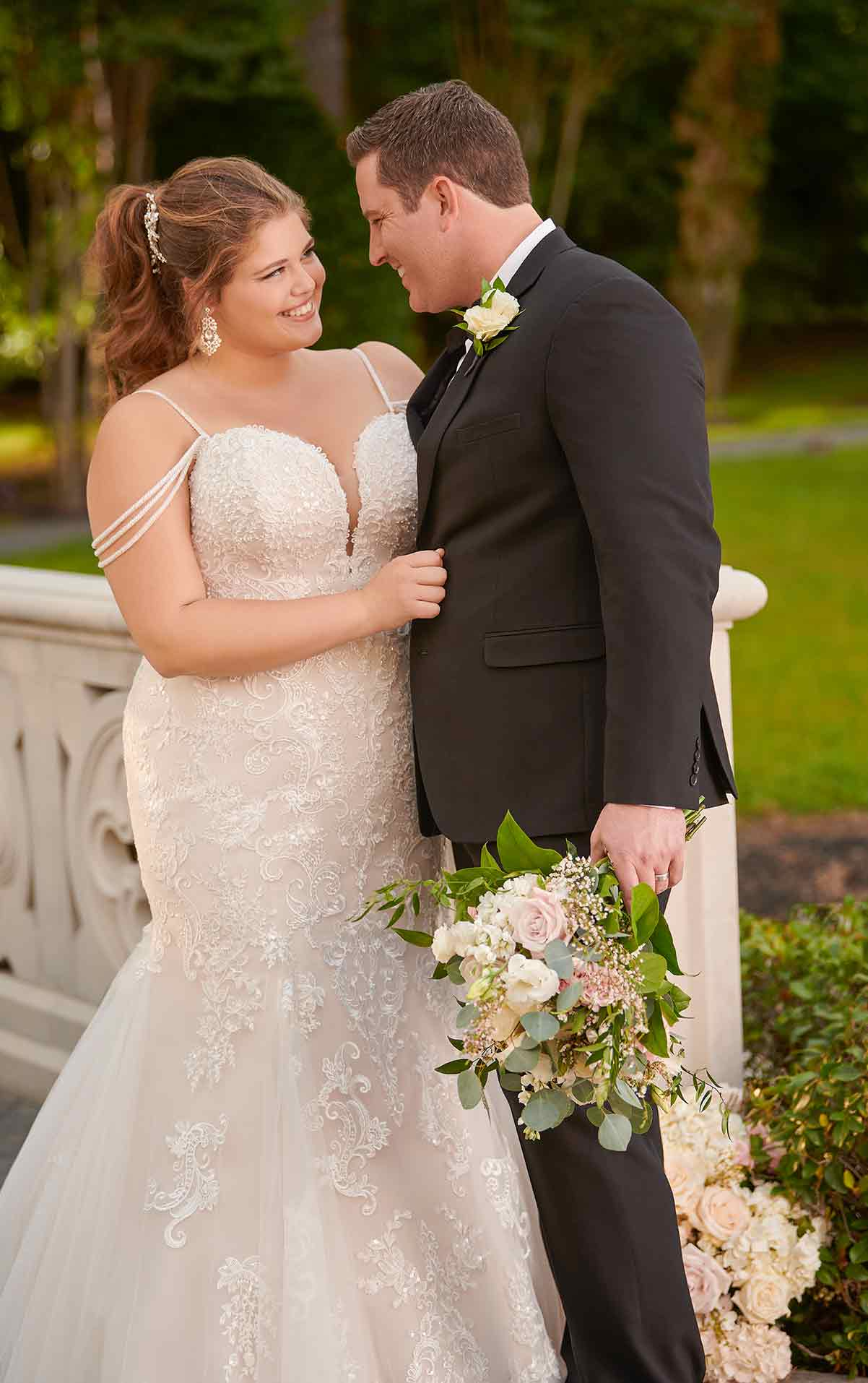 plus-sized bride in beaded strappy gown