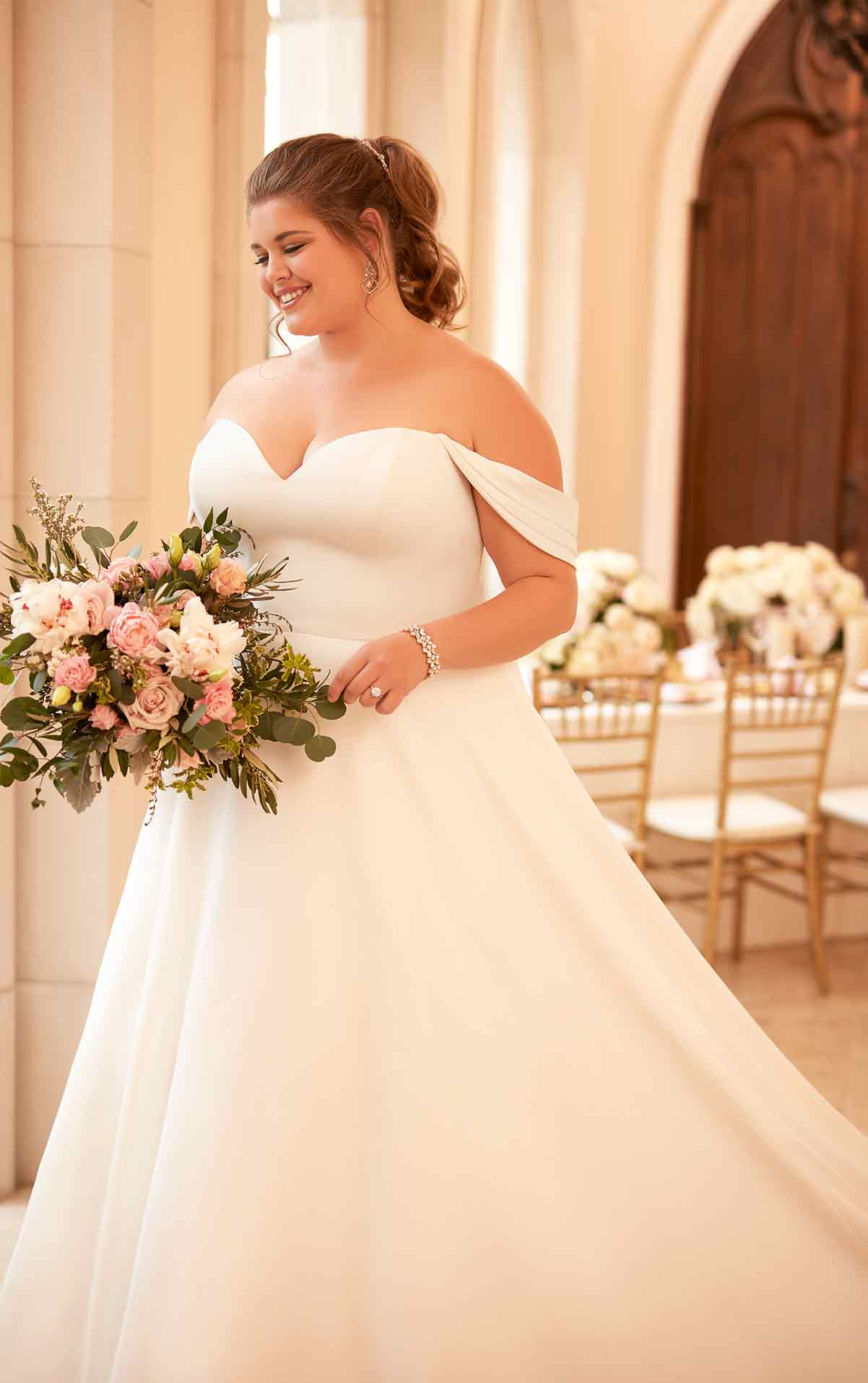 plus-sized bride in satin gown with off the shoulders straps