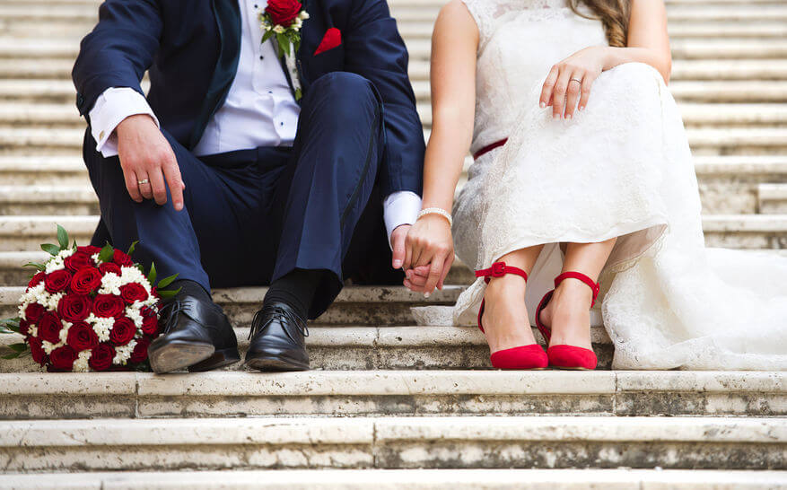 bride wearing bright red shoes.