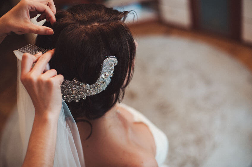 bride wearing veil and hair piece