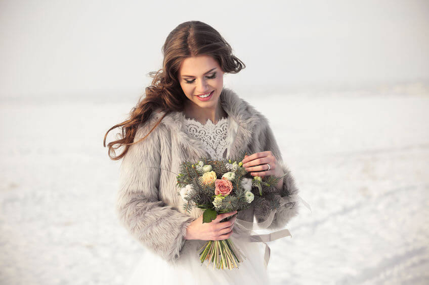 bride wearing a short fur jacket