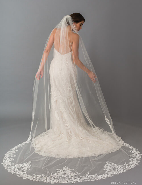 Gorgeous long veil featuring an edging of Venice lace.