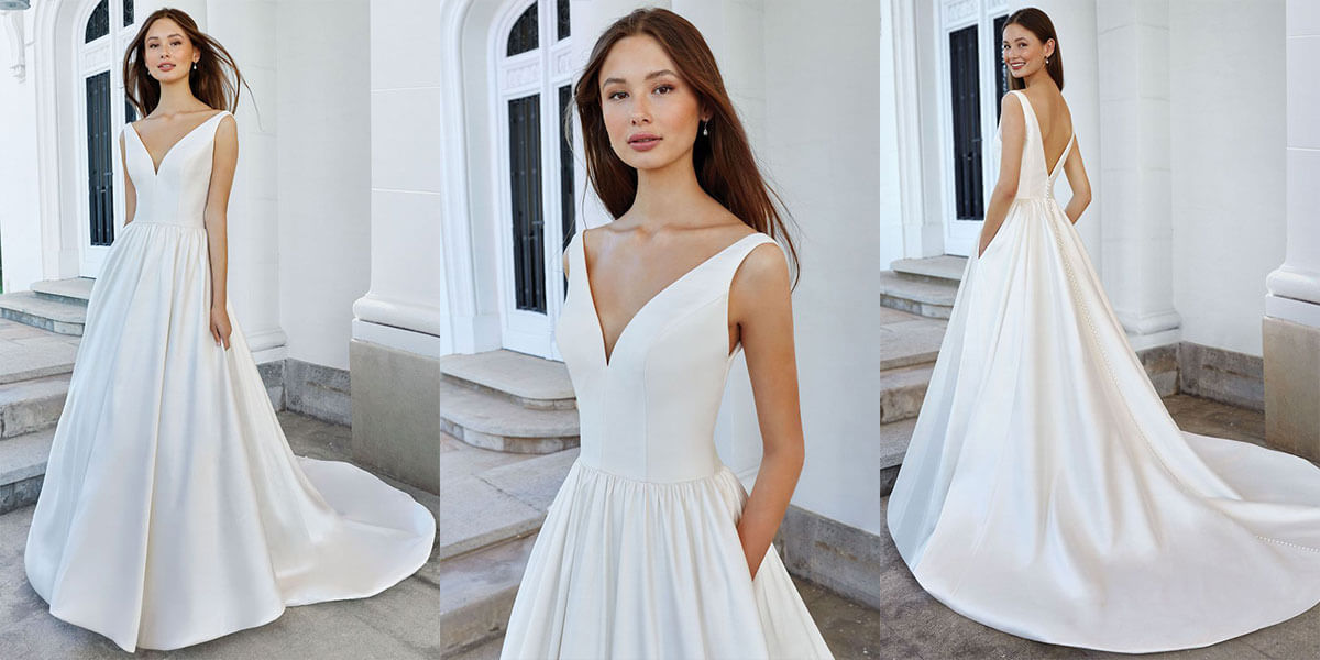 A Justin Alexander ball gown with deep V neckline