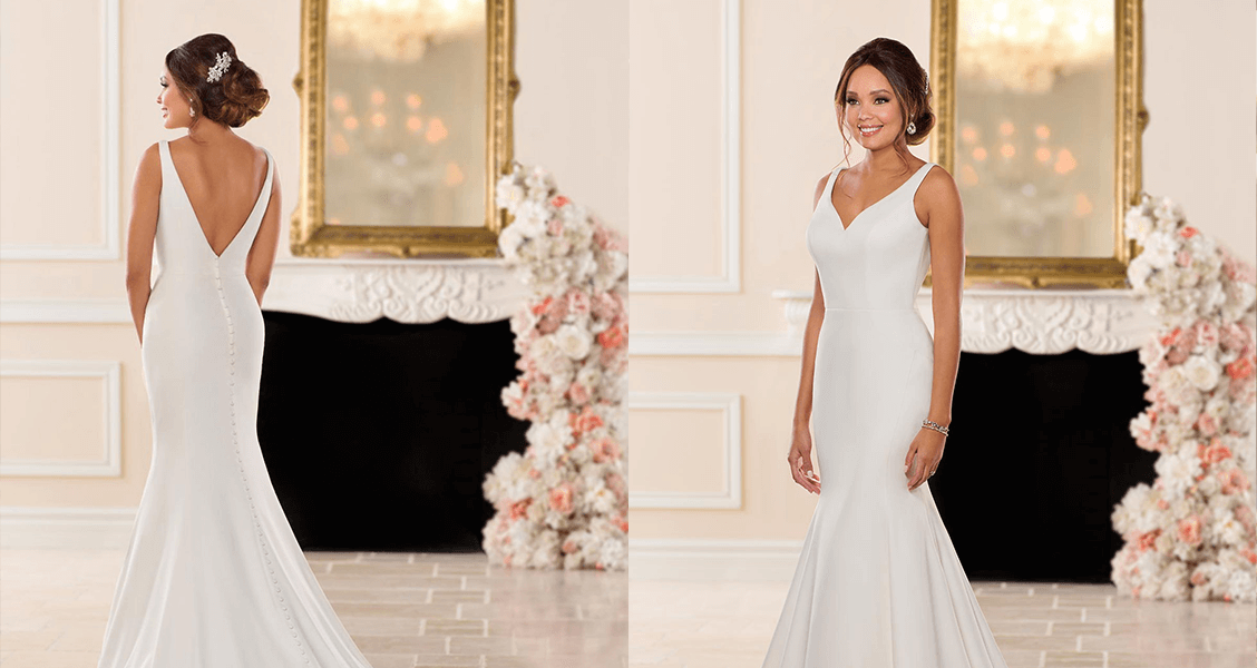 The Paris dress from Stella York featuring a trumpet silhouette and a curved V neckline.